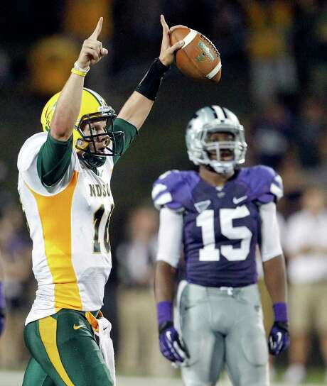North Dakota State quarterback Brock Jensen, left, engineered a 24-21 victory at Kansas State on Friday night, showing how competitive the two-time defending FCS champion can be against a team that shared the Big 12 championship last season. Photo: CHRIS NEAL, MBR / TOPEKA CAPITAL-JOURNAL