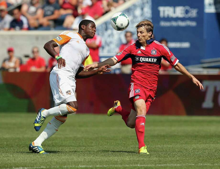Dynamo 1, Fire 1BRIDGEVIEW, IL - SEPTEMBER 01: Chris Rolfe #17 of the Chicago Fire and Kofi Sarkodie #8 of the Houston Dynamo battle for the ball during an MLS match at Toyota Park on September 1, 2013 in Bridgeview, Illinois. The Fire and the Dynamo tied 1-1. Photo: Jonathan Daniel, Getty Images / 2013 Getty Images