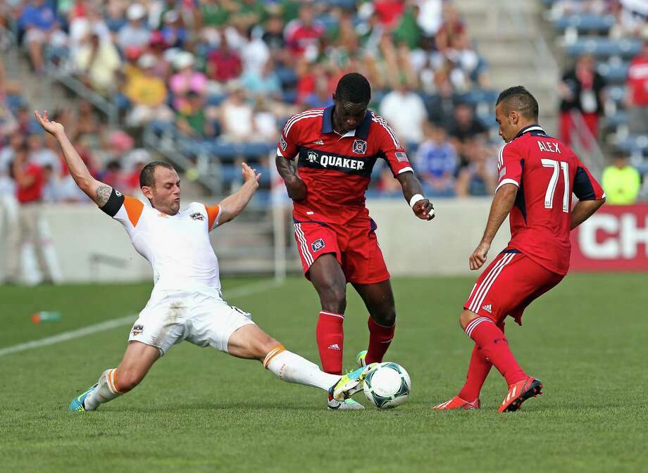Dynamo 1, Fire 1BRIDGEVIEW, IL - SEPTEMBER 01: Brad Davis #11 of the Houston Dynamo kicks the ball between Jalil Anibaba #6 and Alex #71 of the Chicago Fire during an MLS match at Toyota Park on September 1, 2013 in Bridgeview, Illinois. Photo: Jonathan Daniel, Getty Images / 2013 Getty Images
