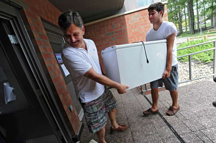 Rich Casagrande, of Guilderland helps his son Michael, 20, a junior at Skidmore College, move a refrigerator into his residence hall as students return to school on Sunday, Sept. 1, 2013 in Saratoga Springs, N.Y.  (Lori Van Buren / Times Union) Photo: Lori Van Buren / 00023570A