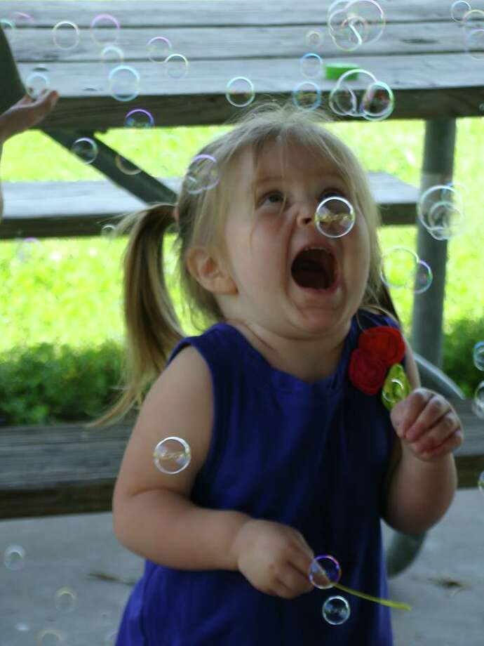 Grace Lagant of Albany celebrates her second birthday with her favorite gift: a bubble machine. (Linda Lagant)