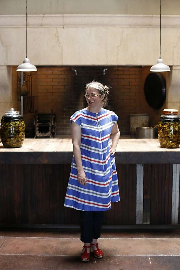Allison Hopelain, co-owner of Camino restaurant in Oakland, sports a bright vintage housecoat and braids. Photo: Katie Meek, The Chronicle