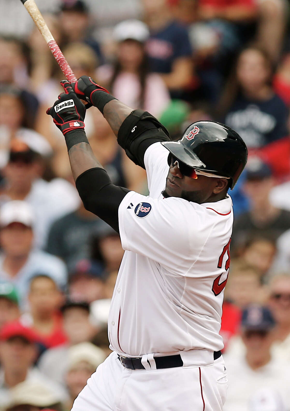 BOSTON, MA - SEPTEMBER 1: David Ortiz #34 of the Boston Red Sox follows through on a RBI single against the Chicago White Sox during the fifth inning at Fenway Park on September 1, 2013 in Boston, Massachusetts. (Photo by Winslow Townson/Getty Images) ORG XMIT: 163495307