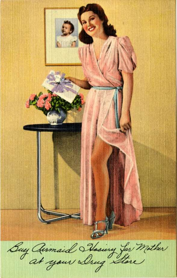 UNITED STATES - CIRCA 1941:  Vintage linen postcard showing a woman holding a gift who is pulling aside her dressing gown to show off her hosiery.  (Photo by Lake County Museum/Getty Images) Photo: Getty Images
