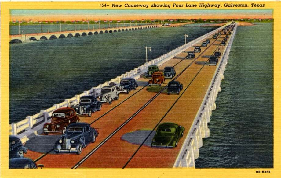 UNITED STATES - CIRCA 1940:  Postcard view of the causeway over Galveston Bay to Galveston, Texas shows vintage automobiles driving along the four lane highway.  (Photo by Lake County Museum/Getty Images) Photo: Getty Images