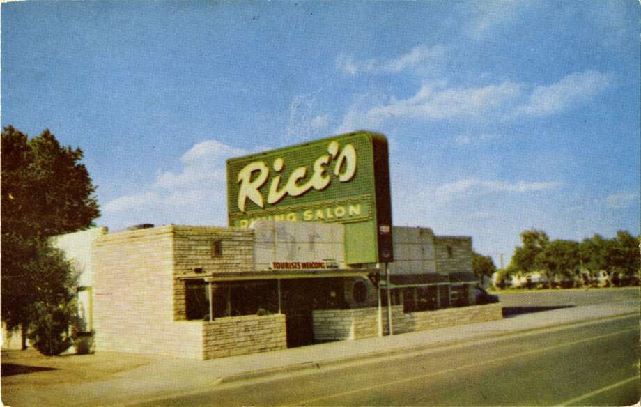 UNITED STATES - CIRCA 1900:  Postcard view of the exterior of Rice's restaurant shows the brick construction and neon sign.  (Photo by Lake County Museum/Getty Images) Photo: Getty Images