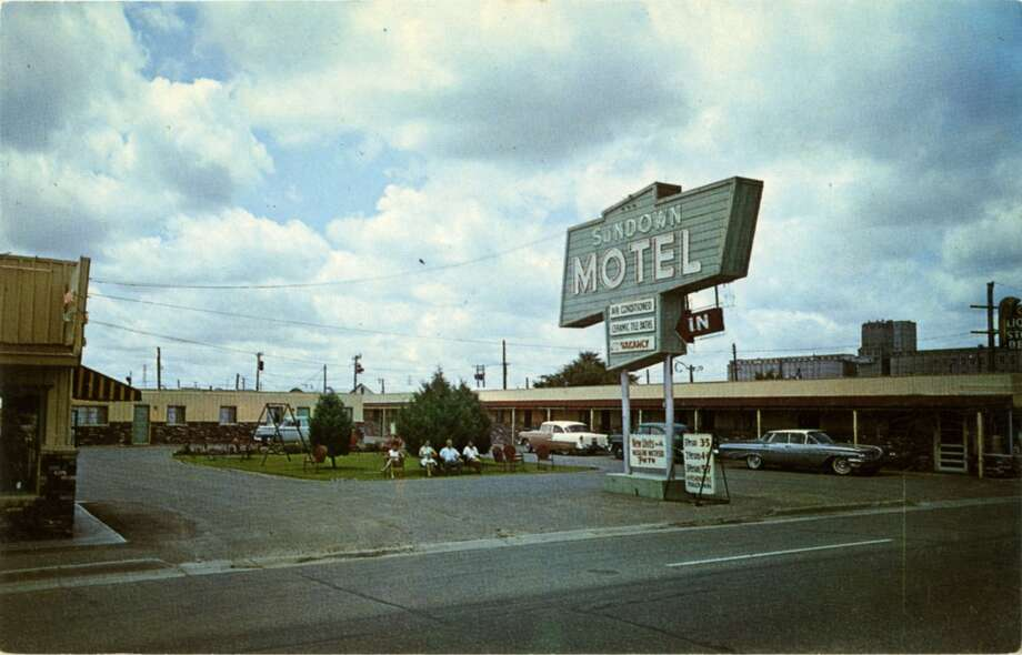UNITED STATES - CIRCA 1900:  Postcard view of the exterior of the Sundown Motel showing the one story building, vintage autos and a large neon sign.  (Photo by Lake County Museum/Getty Images) Photo: Getty Images