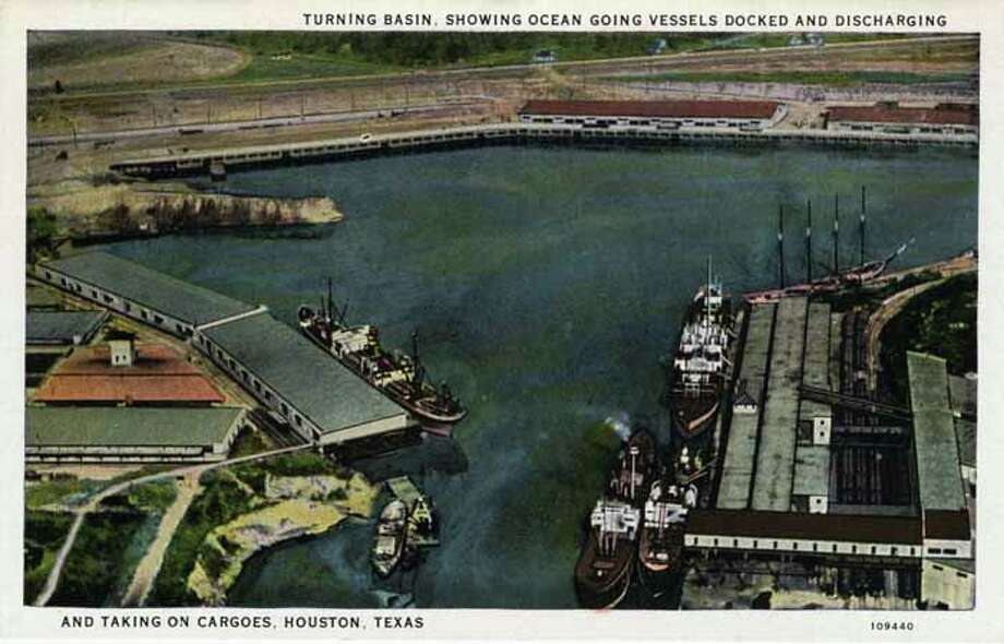 HOUSTON - 1926:  Vintage postcard of the Turning basin showing ocean going vessels docked and discharging and taking on cargoes Four large ships are in the basin. (Photo by Lake County Museum/Getty Images) Photo: Curt Teich Postcard Archives, Getty Images / Archive Photos