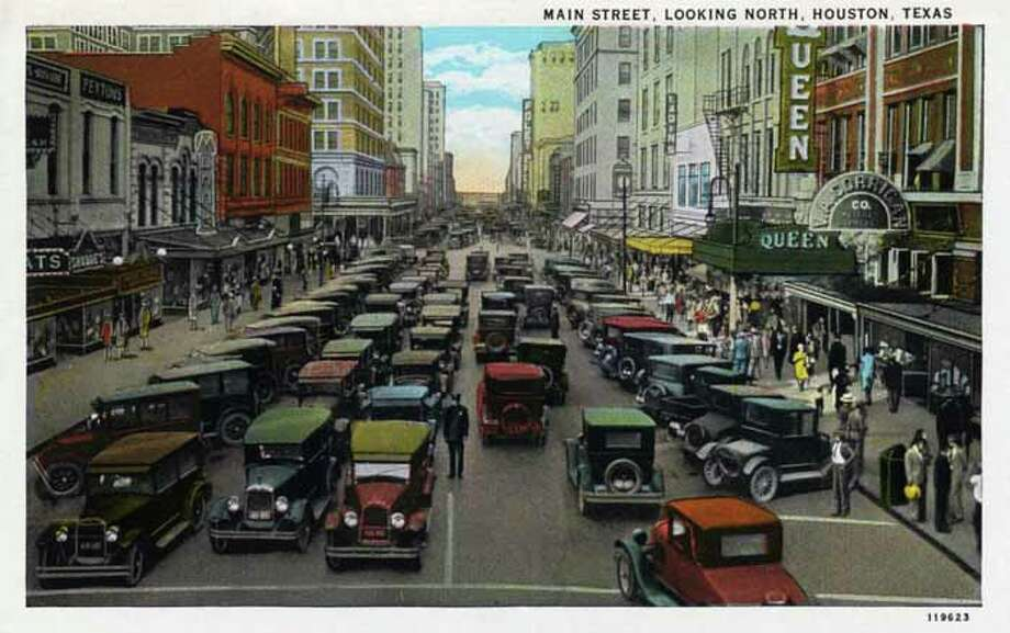 HOUSTON - 1928:  Vintage postcard showing Main Street in Houston, looking north  The street is packed with automobiles and pedestrians crowd the sidewalk. (Photo by Lake County Museum/Getty Images) Photo: Curt Teich Postcard Archives, Getty Images / Archive Photos