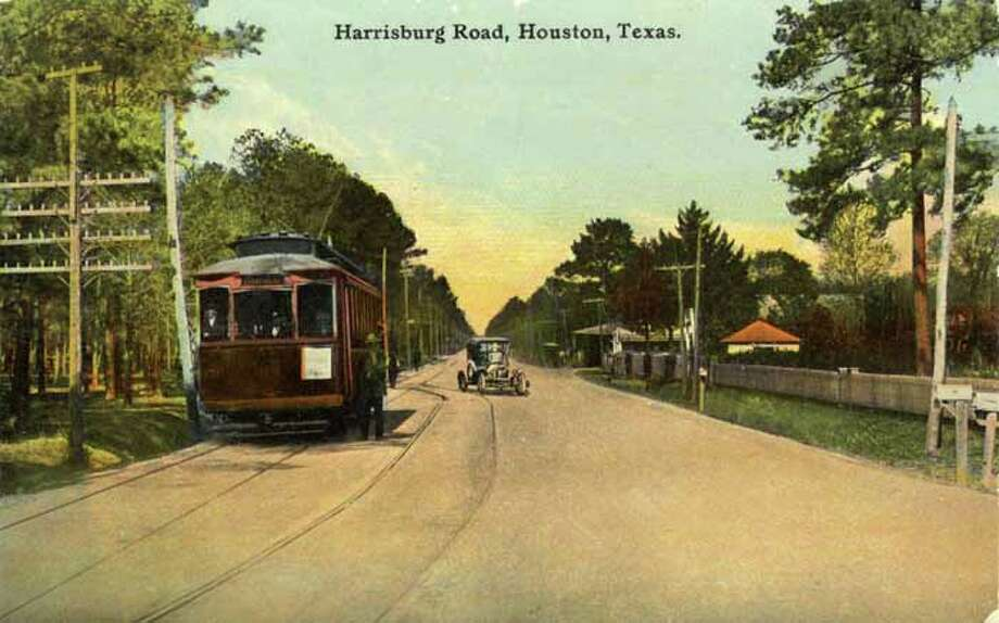 HOUSTON - 1909:  Vintage postcard showing a view down Harrisburg Road in Houston. (Photo by Lake County Museum/Getty Images) Photo: Curt Teich Postcard Archives, Getty Images / Archive Photos