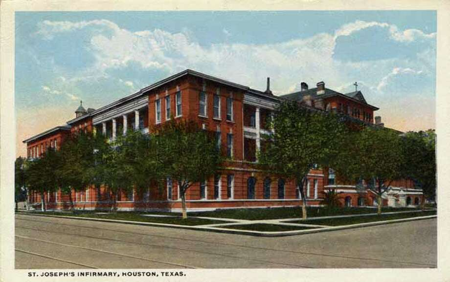 HOUSTON - 1918:  Vintage postcard showing the exterior of St Joseph's infirmary, a red brick three story building. (Photo by Lake County Museum/Getty Images) Photo: Curt Teich Postcard Archives, Getty Images / Archive Photos