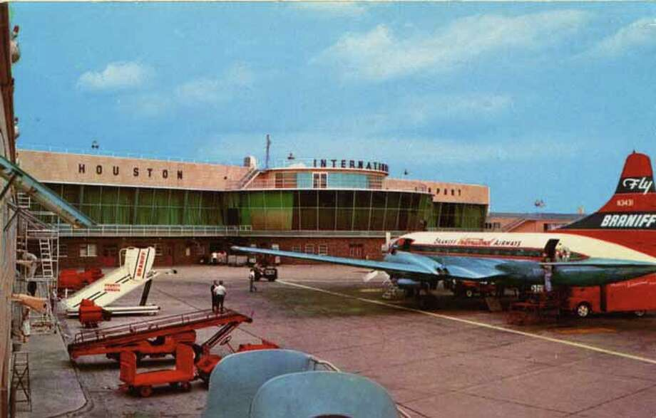 HOUSTON - 1956:  Vintage postcard showing an exterior view of the Houston International Airport, a plane, and assorted airport service vehicles. (Photo by Lake County Museum/Getty Images) Photo: Curt Teich Postcard Archives, Getty Images / Archive Photos