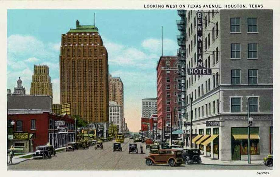 HOUSTON - 1930:  Vintage postcard showing the view west on Texas Avenue Store fronts and high rise buildings line the street The Ben Milam Hotel is on the right Vintage automobiles and a streetcar are on the avenue. (Photo by Lake County Museum/Getty Images) Photo: Curt Teich Postcard Archives, Getty Images / Archive Photos
