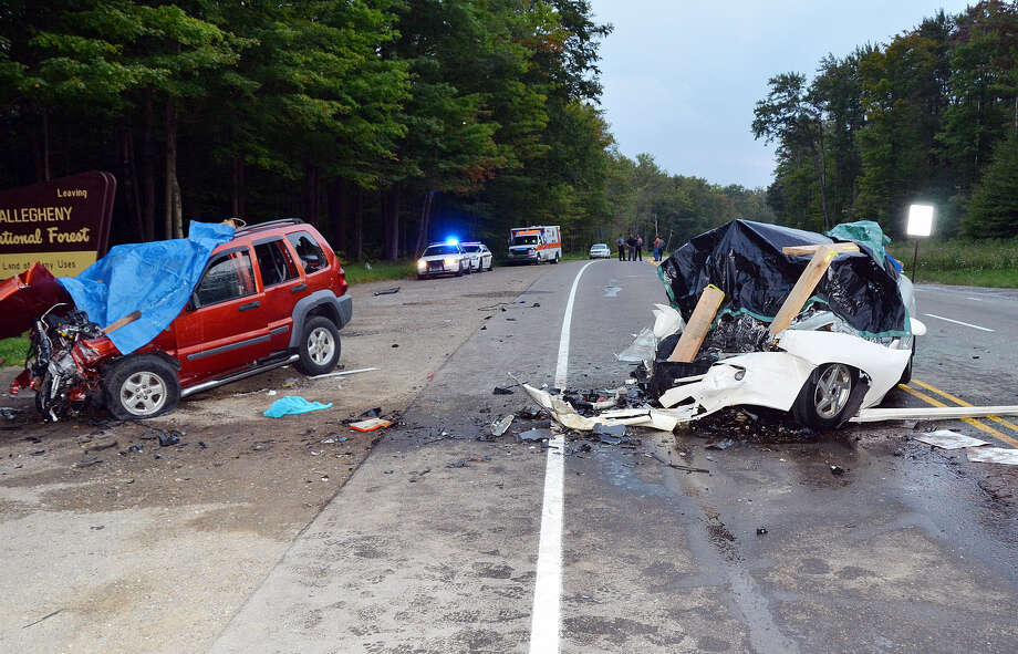 Hamlin Township, Pa., police said Kathy Douglas, 36, was driving the Jeep Liberty (left) that crossed into oncoming traffic on U.S. 219 and smashed head-on into the Pontiac Bonneville, killing six people, including two children. Photo: Jay Bradish / Associated Press
