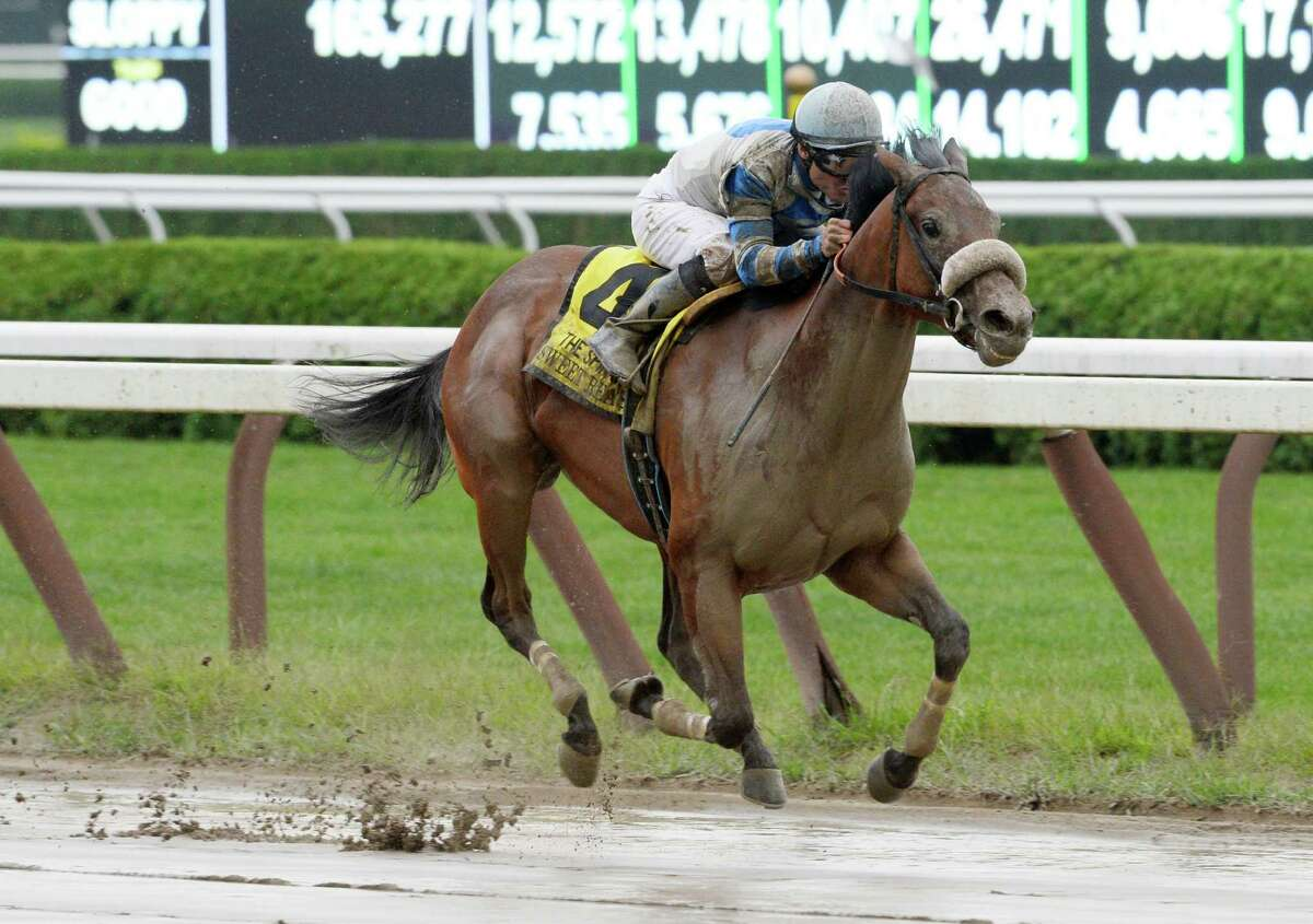 Jockey Alex Solix guides Sweet Reason through the slop to the winner's circle by winning the 122nd running of The Spinaway Sept. 1, 2013, at the Saratoga Race Course in Saratoga Springs, N.Y. (Skip Dickstein/Times Union)