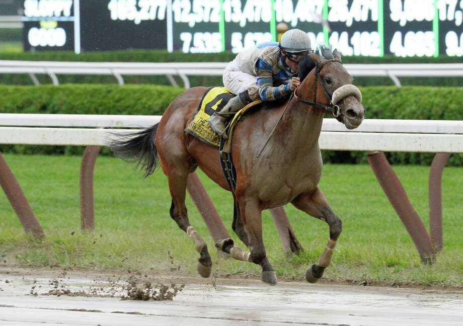 Jockey Alex Solix guides Sweet Reason through the slop to the winner's circle by winning the 122nd running of The Spinaway Sept. 1, 2013,  at the Saratoga Race Course in Saratoga Springs, N.Y.     (Skip Dickstein/Times Union) Photo: SKIP DICKSTEIN