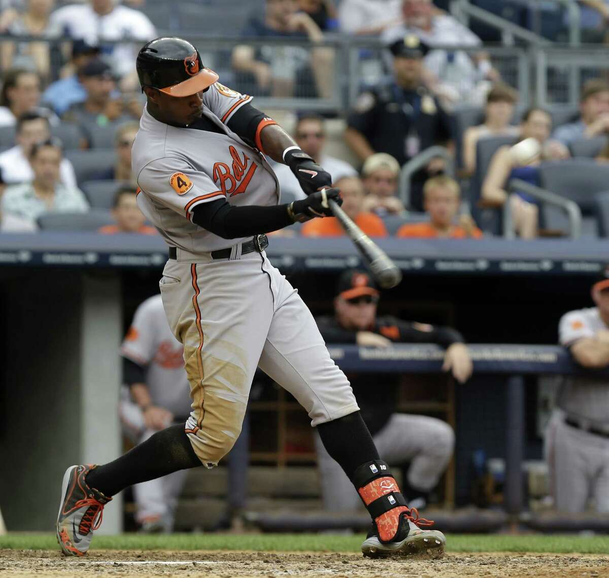 Baltimore Orioles' Adam Jones hits a three-run home run during the seventh inning of the baseball game against the New York Yankees at Yankee Stadium, Sunday, Sept. 1, 2013, in New York. (AP Photo/Seth Wenig) ORG XMIT: NYY111