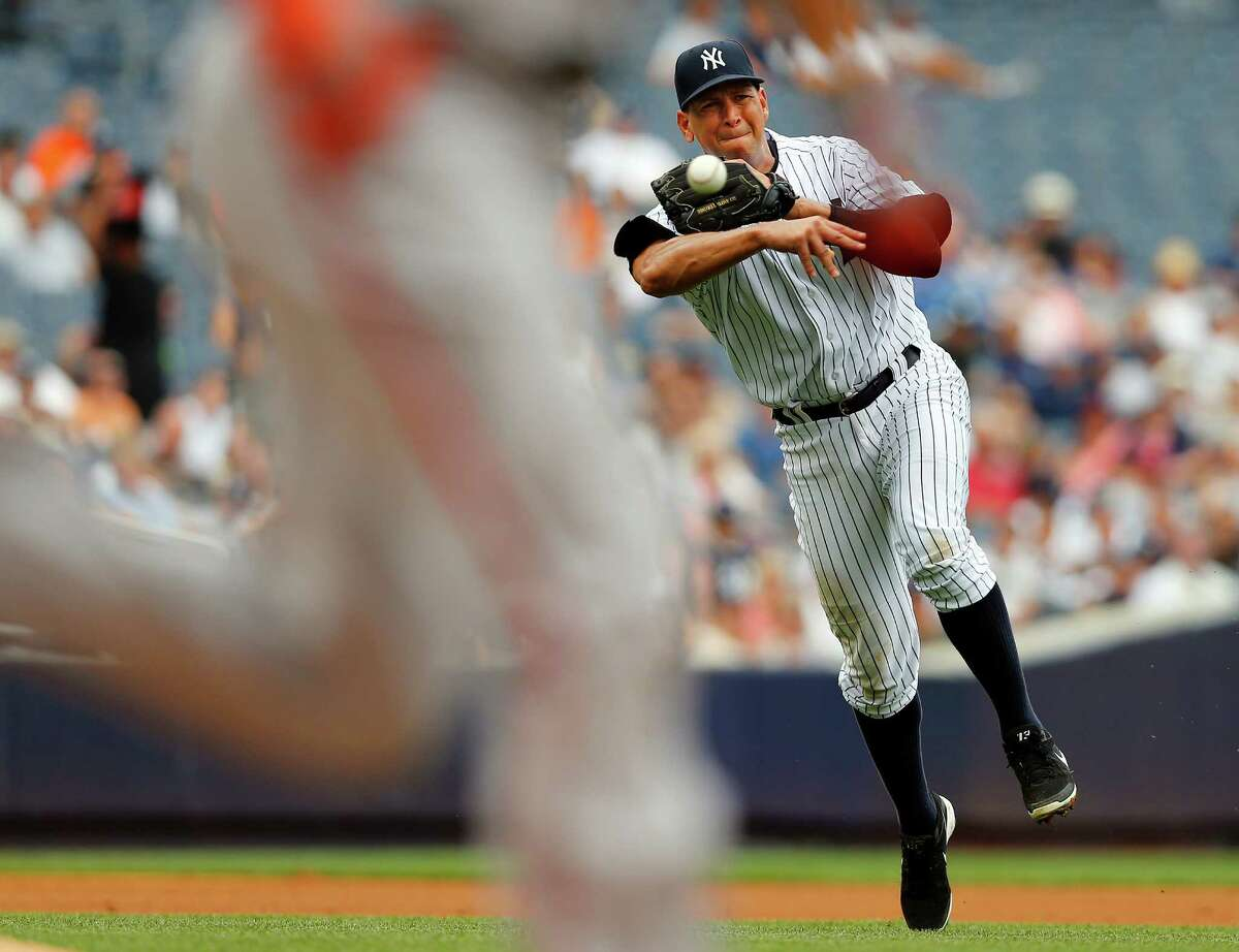 NEW YORK, NY - SEPTEMBER 1: Third baseman Alex Rodriguez #13 throws to first base but Danny Valencia #35 of the Baltimore Orioles beats it out for a single during the fourth inning in a MLB baseball game at Yankee Stadium on September 1, 2013 in the Bronx borough of New York City. (Photo by Rich Schultz/Getty Images) ORG XMIT: 163495313