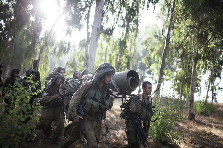 GOLAN HEIGHTS, ISRAEL - SEPTEMBER 01:  Israeli soldiers during a military exercise on September 1, 2013 near the border with Syria, in the Israeli-annexed Golan Heights. Tension's are rising in Israel amid international talks of a military intervention In Syria.  (Photo by Ilia Yefimovich/Getty Images) *** BESTPIX *** ORG XMIT: 178344115 Photo: Ilia Yefimovich / 2013 Getty Images