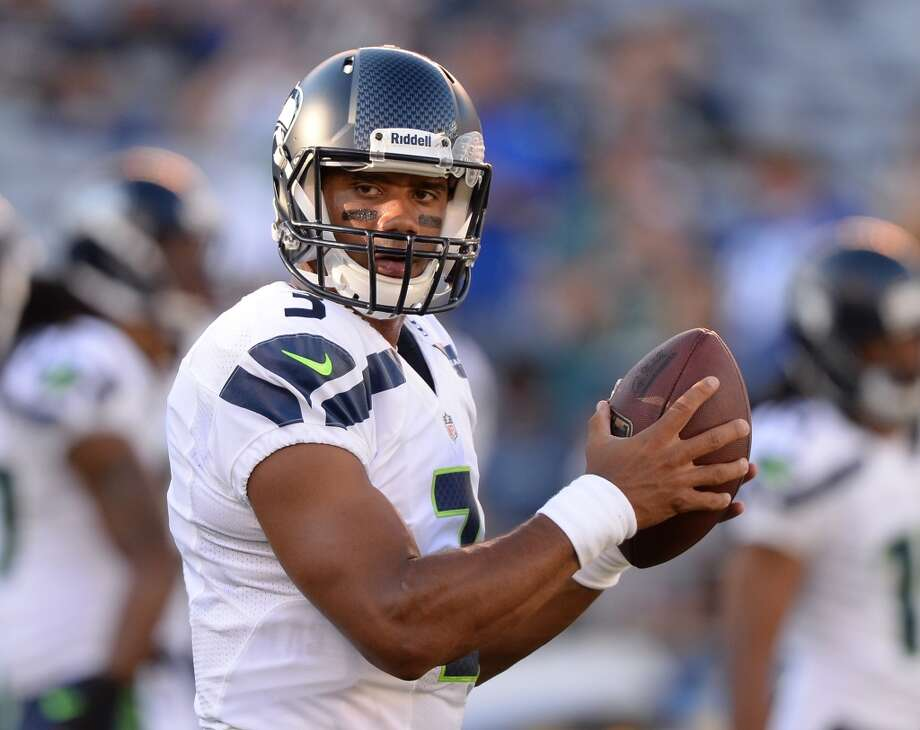#3 | Russell Wilson, quarterback  Age: 24 | 5-foot-11, 206 pounds | College: Wisconsin Second year in NFL | Second year with Seahawks  Hot off his blockbuster rookie season in 2012, Wilson returns as Seattle's clear leader after heading the Seahawks' charge into the playoffs last season. One of the NFL's four sensational young signal-callers, Wilson has quickly become a national star, appearing on the covers of ESPN The Magazine and Sports Illustrated in August. Photo: Harry How, Getty Images