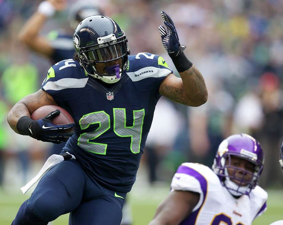 #24 | Marshawn Lynch, running backAge: 27 | 5-foot-11, 215 pounds | College: California Seventh year in NFL | Fourth year with SeahawksLynch is coming off a career-best season in 2012, when he finished third in the NFL with 1,590 yards and 11 touchdowns on 315 regular-season carries -- plus another TD through the air. He's been the heart of Seattle's offense since he arrived partway through 2010, and there's no reason to expect that to change in 2013. Beast Mode is ready to be unleashed once more. Photo: Stephen Brashear, Getty Images / 2012 Getty Images