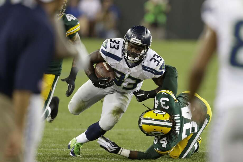 #33 | Christine Michael, running back  Age: 22 | 5-foot-2, 221 pounds | College: Texas A&M NFL rookie | First year with Seahawks  Michael was the Seahawks' first pick in April's NFL Draft, but he wasn't taken until the last pick of the second round. Seattle is lucky Michael dropped that far, because what he has shown this preseason has been nothing short of spectacular. While he struggled in Thursday's preseason finale against the Raiders, he represents a promising future for Seattle's running game. Photo: Mike McGinnis, Getty Images