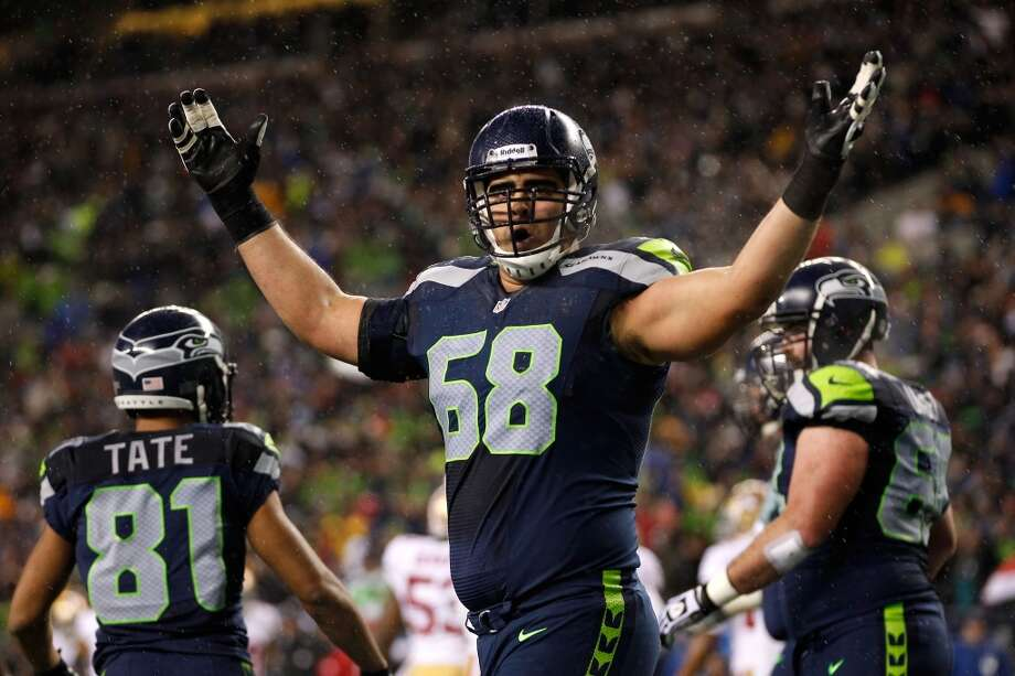 #68 | Breno Giacomini, offensive tackleAge: 27 | 6-foot-7, 318 pounds | College: Louisville Sixth year in NFL | Third year with SeahawksGiacomini may have struggled with penalties last season, but he is a solid right tackle who is integral to the Seahawks' offense. Together with Russell Okung on the other side, Giacomini helped open holes and block for Marshawn Lynch in Lynch's 1,590-yard season in 2012. Photo: Otto Greule Jr, Getty Images