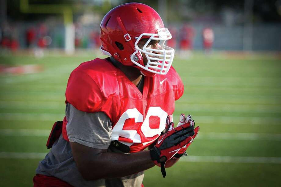 Ralph Oragwu started 10 games at right tackle in 2012, but injuries in 2013 preseason camp forced coaches to move him to left tackle. (Photo courtesy of UH athletics) Photo: UH Athletics
