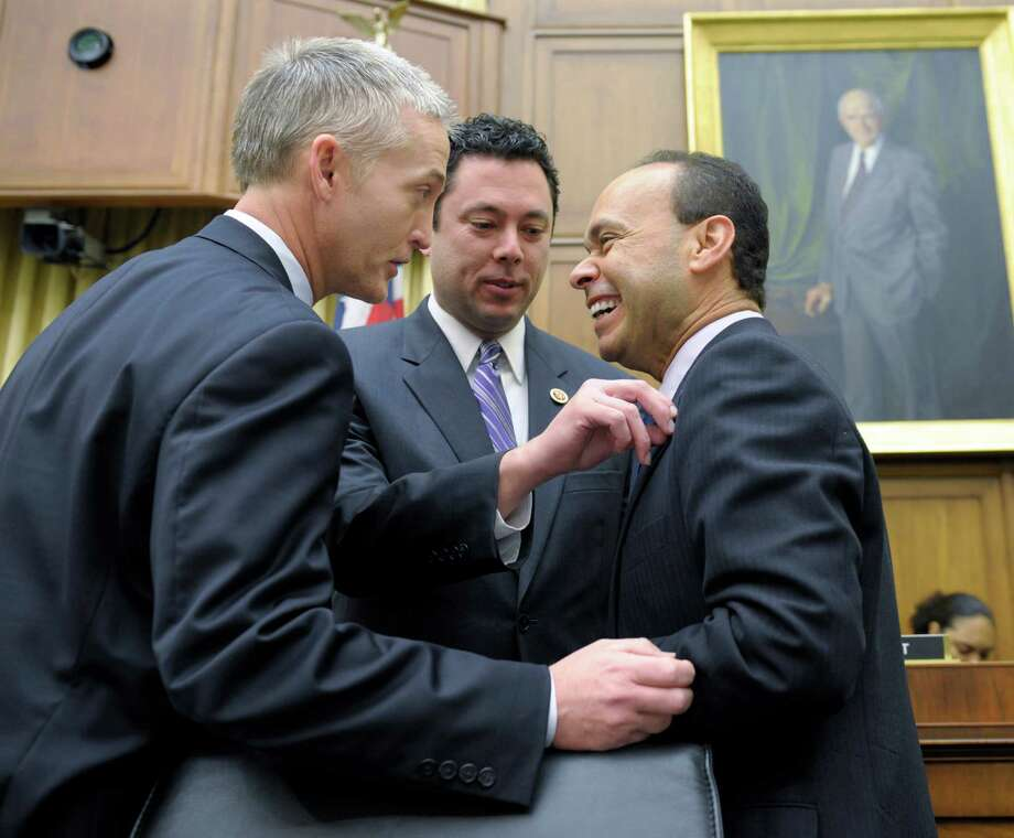 """FILE- In this Feb. 5, 2013, file photo House Judiciary Committee member Rep. Jason Chaffetz, R-Utah, center, Rep. Luis Gutierrez, D-Ill., right, and Rep. Trey Gowdy, R-S.C., share a laugh prior to their committee hearing on immigration reform on Capitol Hill in Washington. The question central to immigration legislation is whether the 11 million immigrants already in the US illegally should get a path to citizenship. The answer from a small but growing number of House Republicans is """"yes"""". But but not a """"special"""" path to citizenship, says Chaffetz. """"But there has to be a legal, lawful way to go through this process that works, and right now it doesn't."""" (AP Photo/Susan Walsh, File) ORG XMIT: WX202 Photo: Susan Walsh / AP"""