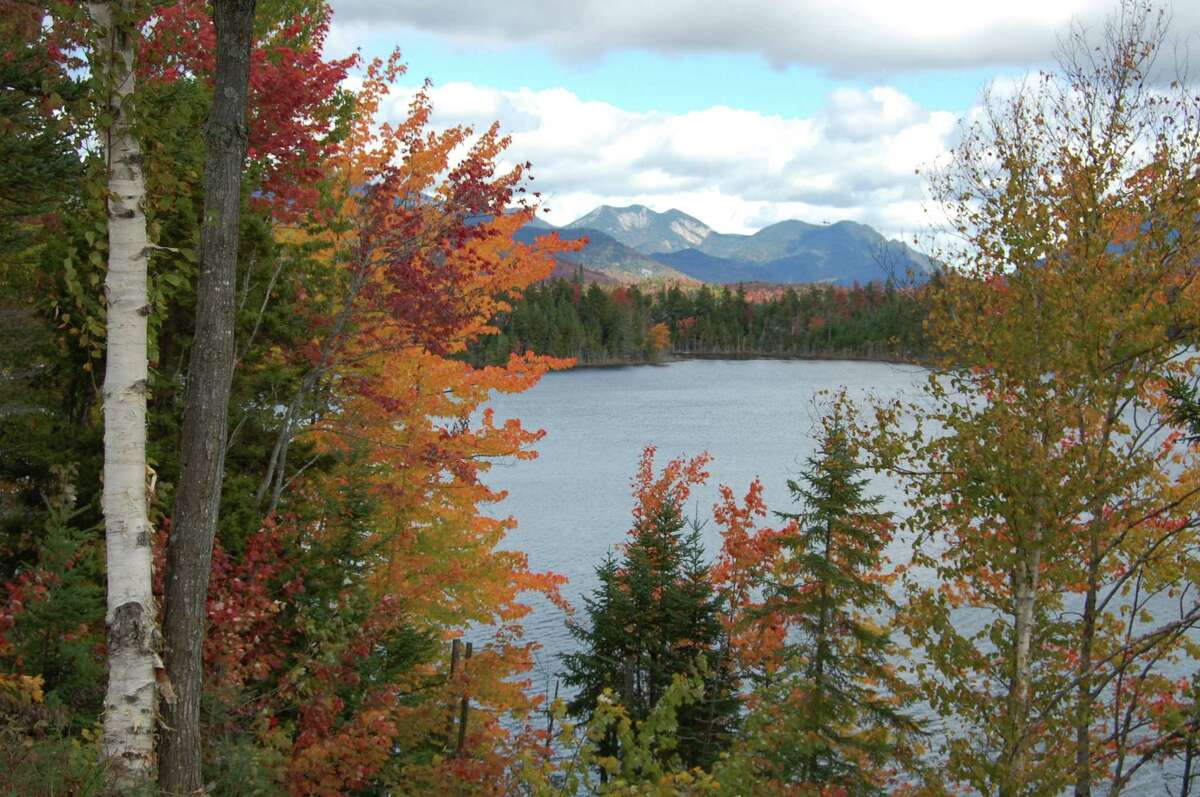 The High Peaks region of the Adirondack mountains towers above Boreas Pond, which is part of the former Finch-Pruyn timberlands, Sept. 23, 2012, in North Hudson, N.Y. (Jimmy Vielkind/Times Union)