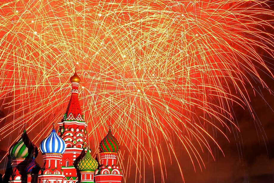 Fireworks explode above St. Basil's Cathedral during the Spasskaya Tower miltary 