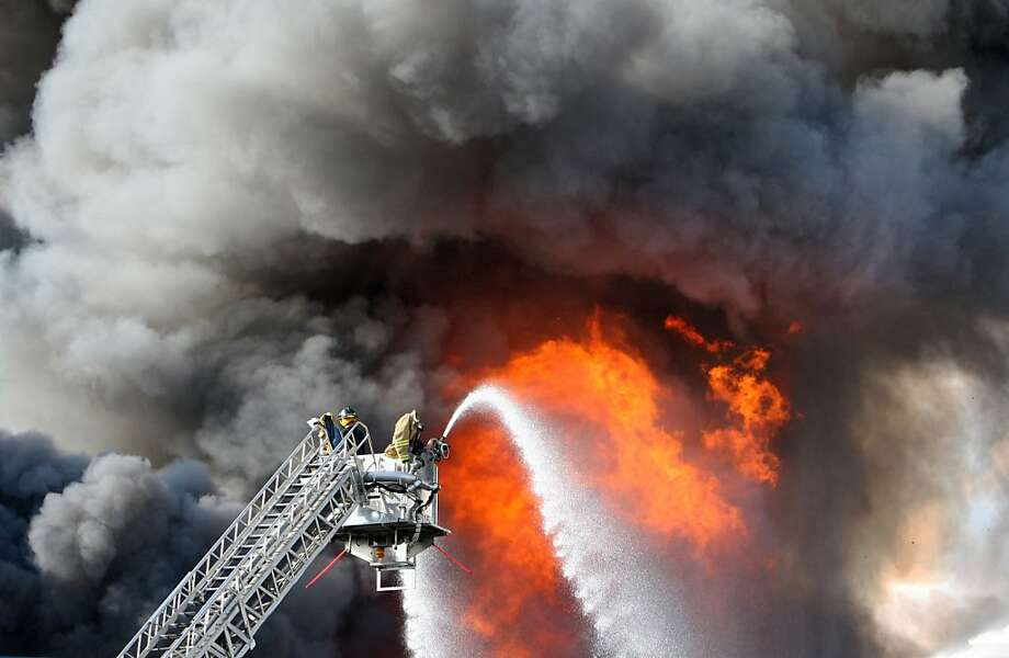 No injuries were reported in a blaze at the Dietz and Watson food distribution plant in Delanco, New Jersey, Sunday, Sept. 1, 2013. Dozens of firefighters battled the blaze which started on the roof and quickly spread, seriously damaging the massive building in Burlington County. (AP Photo/Philadelphia Inquirer, Ron Cortes) Photo: Ron Cortes, Associated Press