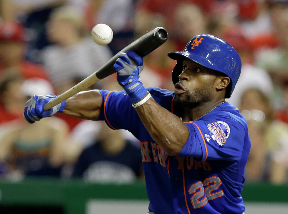 New York Mets' Eric Young Jr. (22) bunts during the fifth inning of a baseball game against the Washington Nationals at Nationals Park, Sunday, Sept. 1, 2013, in Washington. (AP Photo/Alex Brandon) ORG XMIT: NAT107