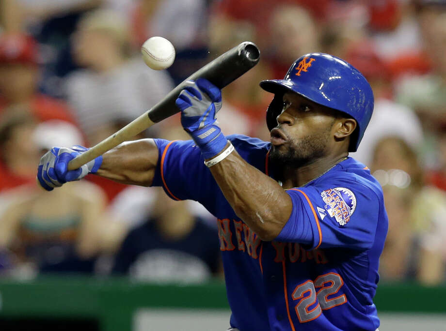 New York Mets' Eric Young Jr. (22) bunts during the fifth inning of a baseball game against the Washington Nationals at Nationals Park, Sunday, Sept. 1, 2013, in Washington. (AP Photo/Alex Brandon) ORG XMIT: NAT107 Photo: Alex Brandon / AP