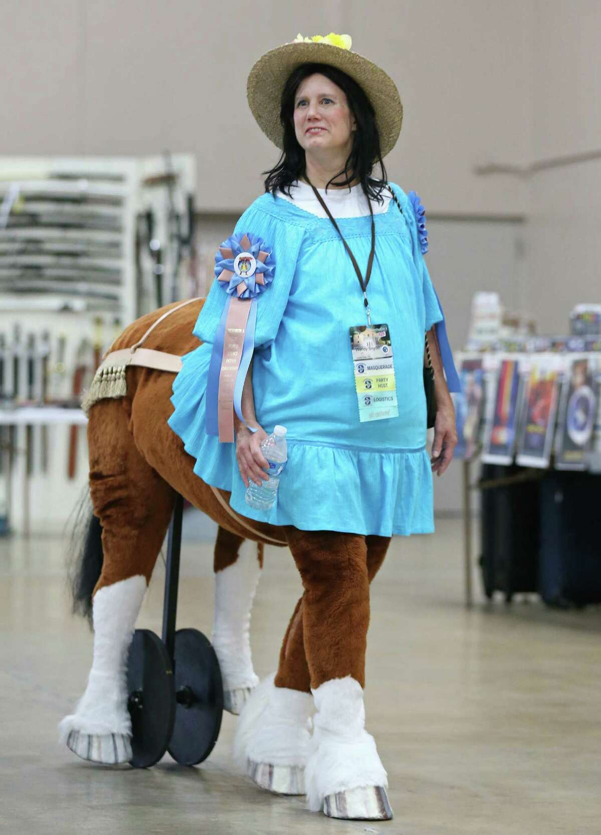 Wearing a centaur costume Wendy Snyder, 53, of Cedar Park, TX, takes in the sights while attending the 71st Annual World Science Fiction Convention Sunday Sept. 1, 2013 at the Henry B. Gonzalez Convention Center.