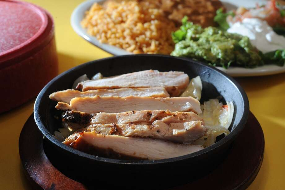 Chicken fajitas at Casa Ole in Beaumont. Photo taken Wednesday, August 21, 2013 Guiseppe Barranco/The Enterprise Photo: Guiseppe Barranco/The Enterprise