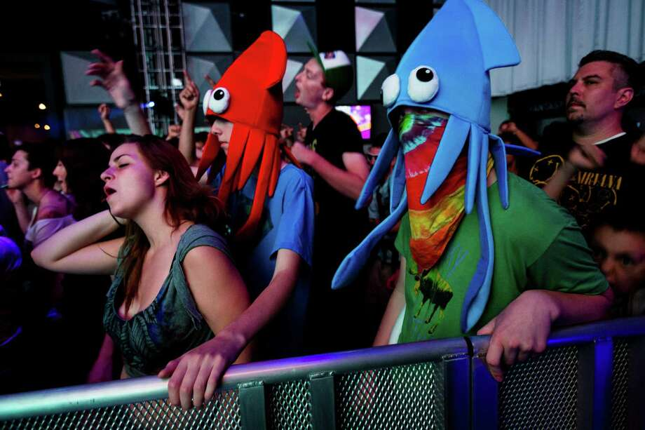 Squids dance in unison with attendees to the beat of electronic music in EMP's Sky Church on the second day of the annual Bumbershoot arts and music festival Sunday, September 1, 2013, at Seattle Center in Seattle. The festival continues Monday. Photo: JORDAN STEAD, SEATTLEPI.COM / SEATTLEPI.COM