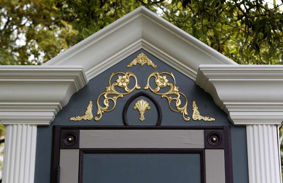 Fancy gold-colored details decorate a Victorian-themed booth designed to disguise a portable toilet. Photo: Paul Chinn, The Chronicle