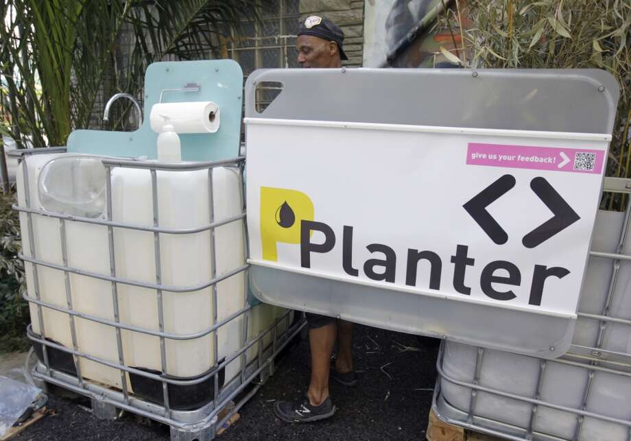 "Unlike the other toilet covers, the ""P Planter"" in the Tenderloin isn't discreet. It diverts and treats urine to irrigate plants. Photo: Paul Chinn, The Chronicle"