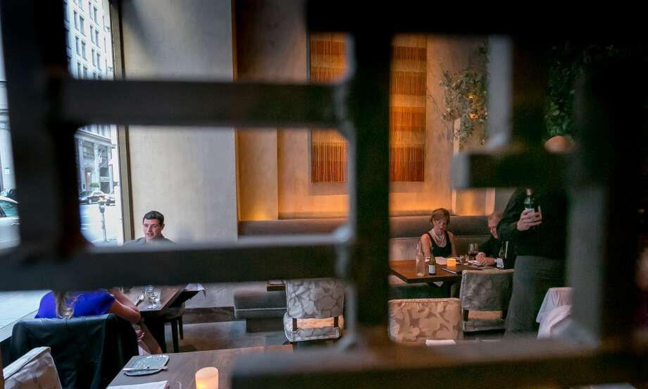 Diners enjoy dinner at Michael Mina in San Francisco. Photo: John Storey, Special To The Chronicle