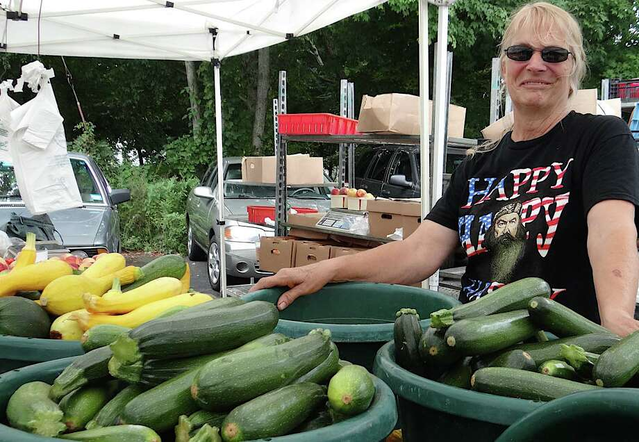 Nancy Hubbert of Smith Acres Farm in Niantic offered fresh-picked produce, fruit, honey and cut flowers Sunday at the farmers market at Christie's Country Store. Photo: Mike Lauterborn / Westport News contributed