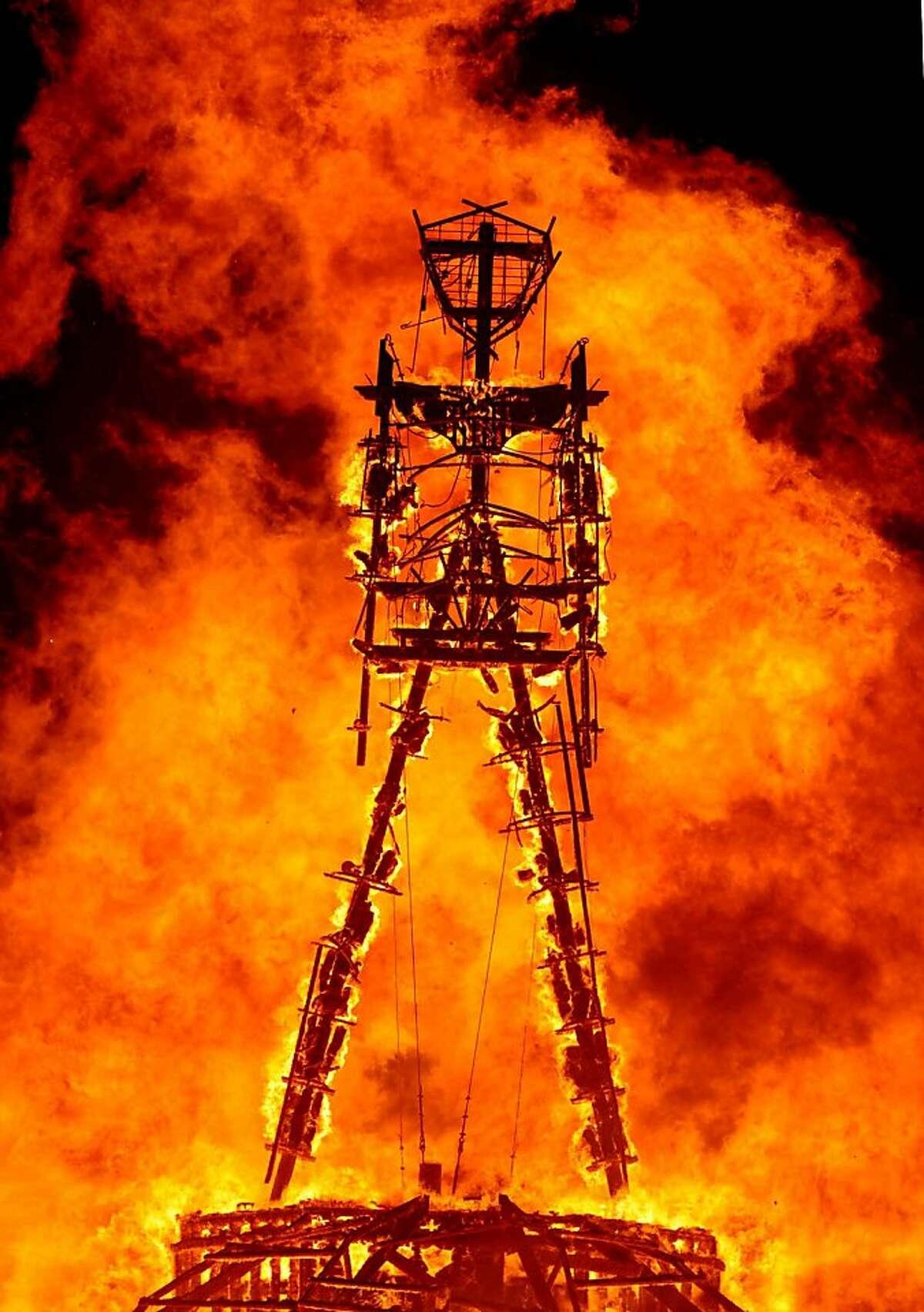 """The """"Man"""" burns on the Black Rock Desert at Burning Man near Gerlach, Nev. on August 31, 2013."""