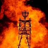 """The """"Man"""" burns on the Black Rock Desert on August 31, 2013."""