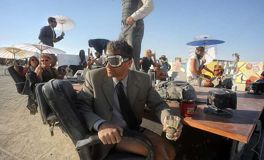 "A ""Mobile Board Room"" moves along the playa at the Burning Man festival in Gerlach, Nev. on Thursday, Aug. 29, 2013. Once a year, tens of thousands of participants gather in Nevada's Black Rock Desert for the counterculture event. Photo: Andy Barron, Associated Press"
