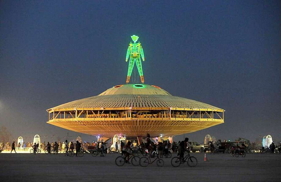 "The ""Man"" sculpture is illuminated after sunset at the Burning Man festival in Gerlach, Nev. on Friday, Aug. 30, 2013. Once a year, tens of thousands of participants gather in Nevada's Black Rock Desert for the counterculture event. Photo: Andy Barron, Associated Press"