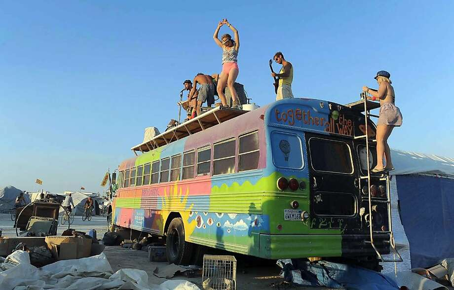 In this Thursday, Aug. 29, 2013 photo, a band plays on top of a bus at Burning Man in Gerlach, Nev. Once a year, tens of thousands of participants gather for Burning Man in Nevada's Black Rock Desert to create Black Rock City, dedicated to community, art, self-expression and self-reliance. Photo: Andy Barron, Associated Press