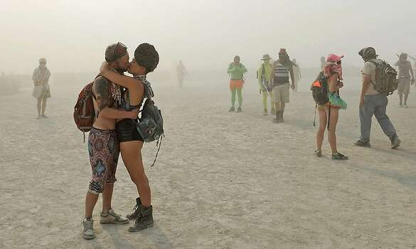 A couple kisses at Burning Man on Aug. 28, 2013.  Photo: Andy Barron, Associated Press