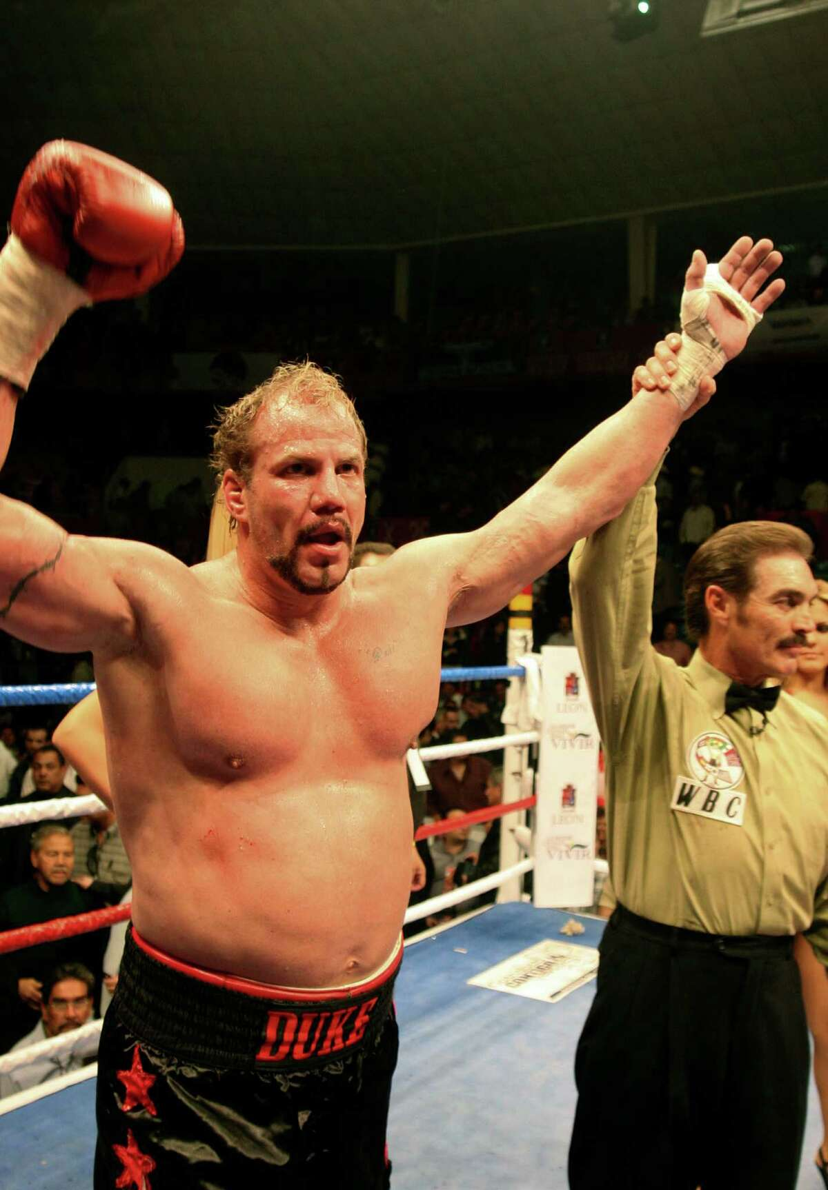 In this Feb. 9, 2008 file photo, former world heavyweight champion Tommy Morrison, celebates after defeating Matt Weishaar in Leon, Mexico.