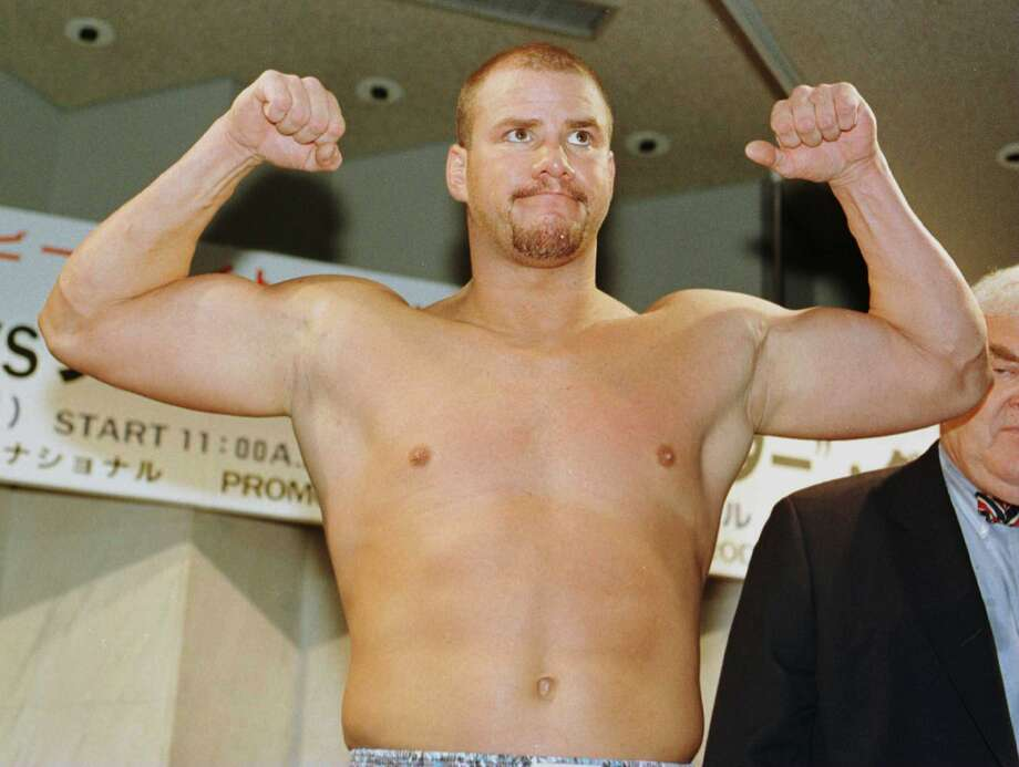 Heavyweight boxer Tommy Morrison weighs in at 228lbs for his comeback fight against Marcus Rhode at the Tokyo Bay NK Hall in Tokyo, Japan, on November 3, 1996. (Al Bello/Getty Images) Photo: Al Bello, Getty Images / Hulton Archive