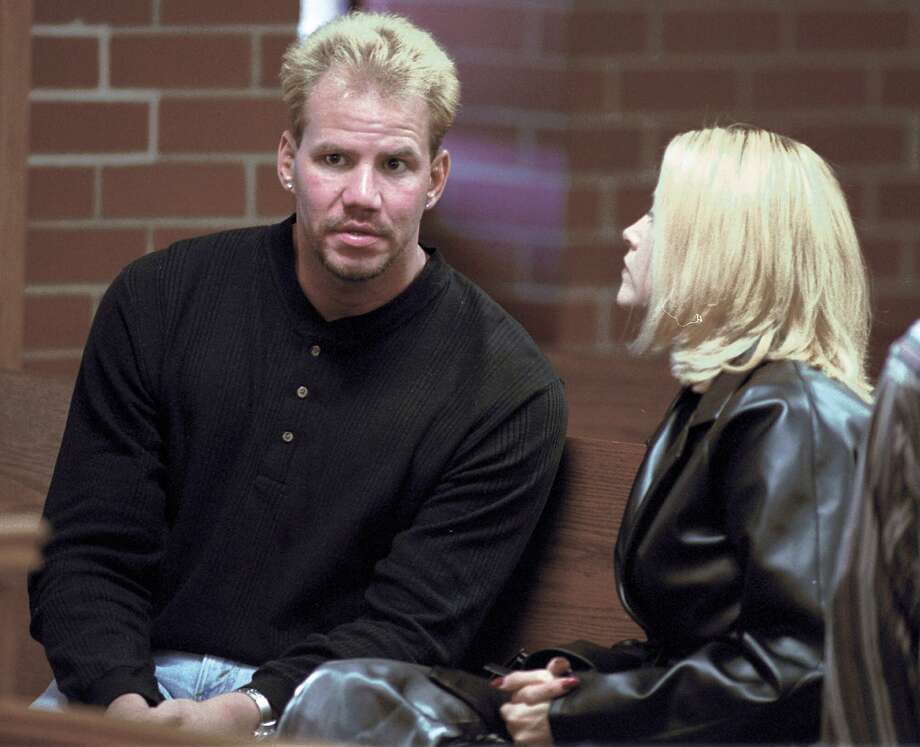 Former World Boxing Organization Heavyweight Champion Tommy Morrison and his wife, Dawn, talk before a hearing in Washington County Circuit Court in Fayetteville, Ark., on Monday, Oct. 18, 1999. Morrision pleaded innocent to felony drug charges and will appear for his  trial in December. Photo: APRIL L. BROWN, AP / AP